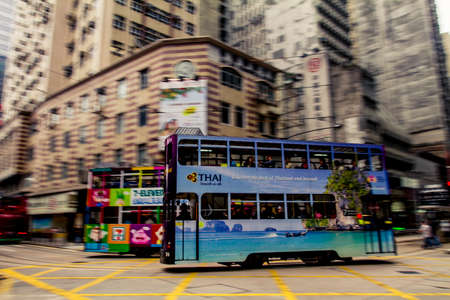 Hong Kong, China - 9 April, 2010: Double deck tram on a busy street in Sheung Wan district of Hong Kong Editorial