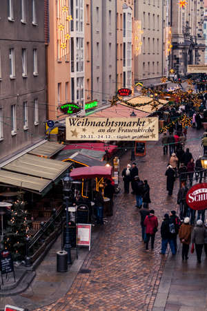 Dresden, Germany - 1 Jan. 2008: Christmas market with people during the daytime next to the Frauenkirche in Dresden
