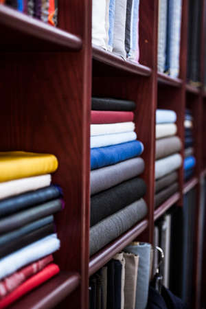 tailored: Many types of fine cloth at a bespoke tailor shop