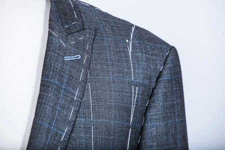 tailored: Details of a tailored suit jacket with markings on it for stitching, cutting and tailoring