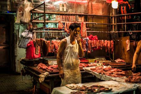 chun: Hong Kong, China - 7 July, 2013: Butchers wait for customers at Chun Yeung Street Market in North Point District