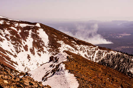 flagstaff: Smoke from a forest fire seen from the top of a nearby mountain