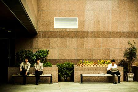 Hong Kong, China - 19 May, 2009: Employees of a restaurant taking a smoking break from work at Victoria Peak Editorial