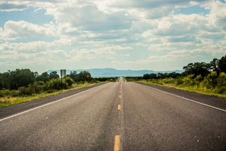 Road tripping through the American Southwest with long stretches of empty highways