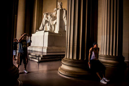 Washington D.C., USA - 31 August, 2009: Tourists admiring the state of Abraham Lincoln at his memorial in the national capitol