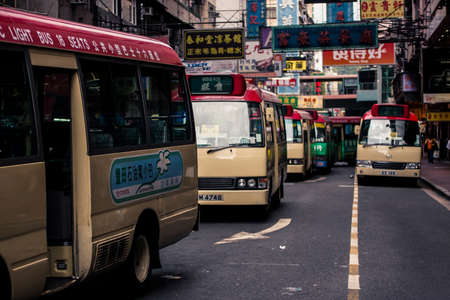 Hong Kong, China - 19 May, 2009: Many minibus vans used for public transportation on the street in Mongkok district during the daytime
