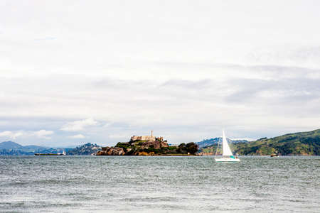 alcatraz: Alcatraz and a sailboat in San Francisco, California, USA.