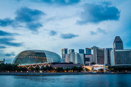 Singapore, Singapore - 20 May, 2010: Skyline of the city with the opera and theater house on the waterfront Redakční