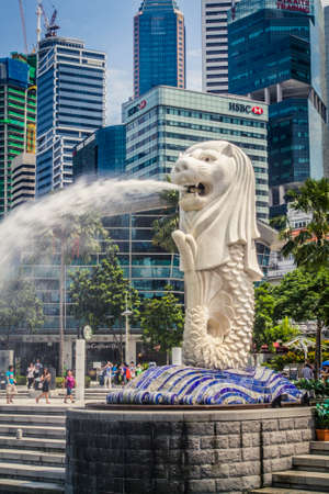 Singapore, Singapore - 20 May, 2010: The infamous Merlion and skyline with the bay