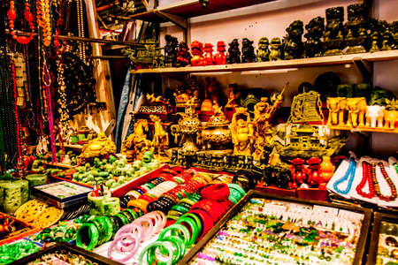 Hong Kong, China - 2 June, 2009: Ornate trinkets and carved items for sale at the Jade Market in Yau Ma Tei district in Kowloon during the daytime Banco de Imagens