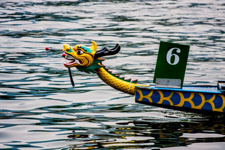 Head of a dragon boat in the water Stock Photo
