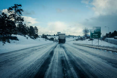 driving conditions: Dangerous driving conditions on slippery roads in the wintertime Stock Photo