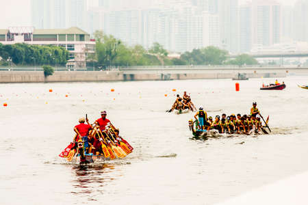 Hong Kong, China - 1 June, 2009: Dragonboat racing, a tradition in Chinese cultures, along the canals in Sha tin district in the New Territories Editorial