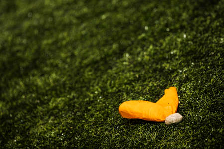 americal: Penalty flag on the grass at an Americal football game