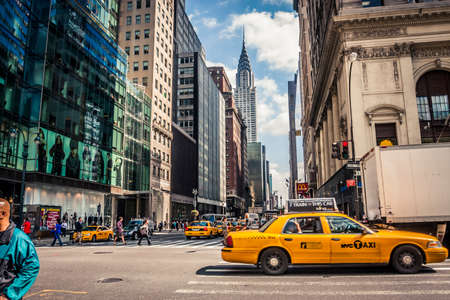 New York, USA - 23 September, 2009: Taxis driving in downtown Manhattan with a view of the Chrystler Building Editorial