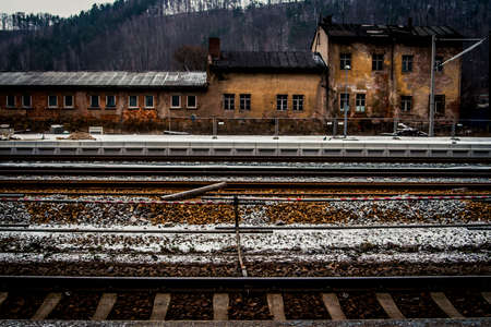 Empty train station in the Czech Republic with a fresh layer of snow on the ground Foto de archivo