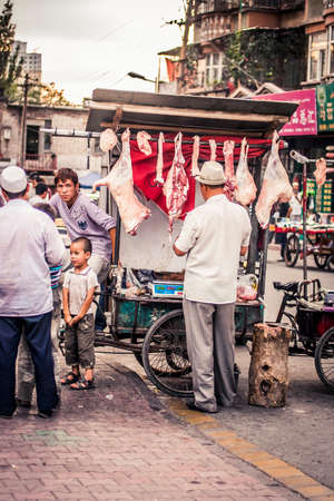 Urumqi, China - 23 June, 2009: Butcher selling lamb in the Islamic district of the city