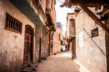 Kashgar, China - 27 June, 2009: Small street in the historic old town district of Kashgar during the daytime