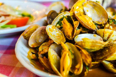 Portuguese style clams served on a white plate in Macau, China