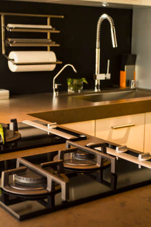 stovetop: Modern kitchen design with neutral colors Editorial