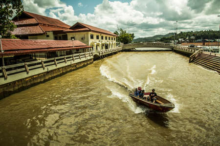Bandar Seri Begawan, Brunei - 3 December, 2009: Boats passing through a canal near the waterfront in the central district of the city Editorial