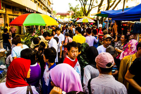 Kota Kinabalu, Malaysia - 6 December, 2009: Weekend market in downtown Kota Kinabalu with many people on a sunny afternoon