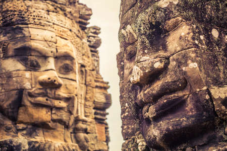 Stone faces carved in ancient Khmer temple of Bayon in Siem Reap, Cambodia 版權商用圖片