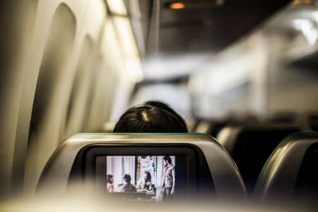747 400: Hong Kong, China - 25 February, 2013: Seatback entertainment system on a Cathay Pacific 747-400 en route from San Francisco to Hong Kong