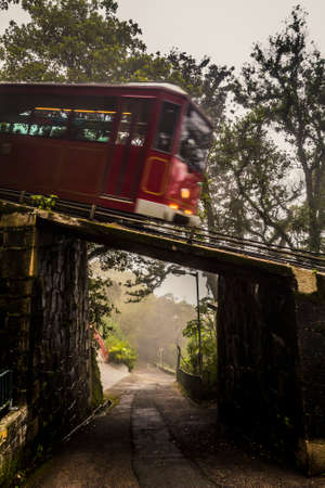 Hong Kong, China - 1 March, 2012: Tram line leading to Victoria Peak on a foggy morning