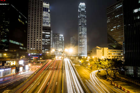 Hong Kong, China - 8 February, 2012: Traffic in Central District  with a view of IFC Two at nighttime Foto de archivo