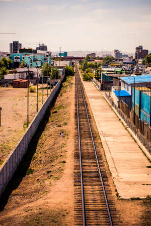 Ulaanbaatar, Mongolia - 29 May, 2013: Railroad tracks leading through the city from the central station in the daytime