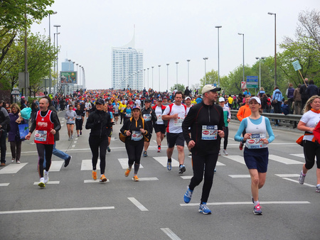 participants: VIENNA, AUSTRIA - APRIL 15, 2012: Participants run in Vienna Marathon. Record edition in 2010 had 32,940 runners from 108 nations.