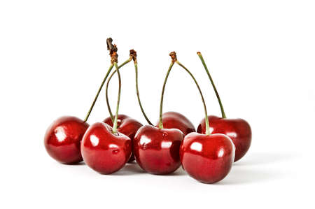 Seven Cherries with Dewdrops on White Background