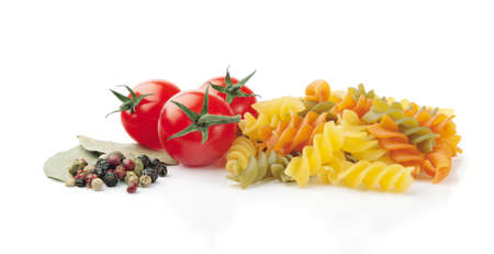Pasta, Tomatoes, Peppercorn and Bay Leaves on White Background