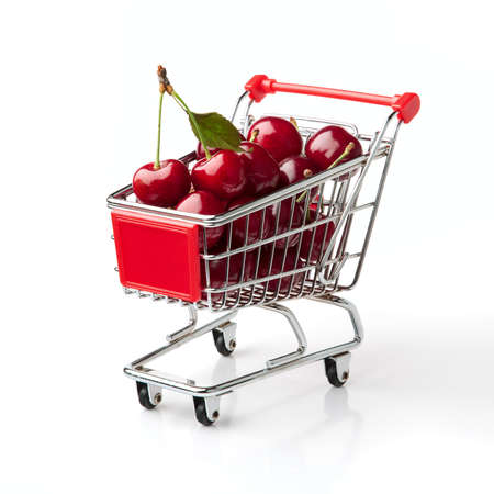 Cherries in Shopping Cart Shopping Cart Isolated On White Background photo
