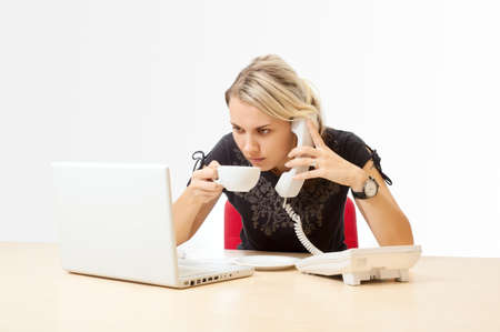 Businesswoman with a telephone in the office Stock Photo - 14920911