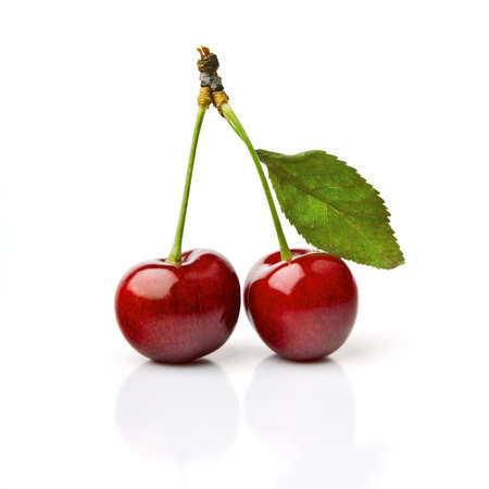 Two Cherries With Dewdrops On White Background Stock Photo