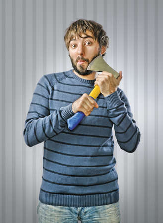 Young Man Shaving with Axe Stock Photo - 15726030