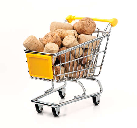 Shopping Cart Filled with Corks, Isolated On White Background Stock Photo