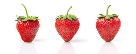 strawberry plant: Three Strawberries Isolated on White Background