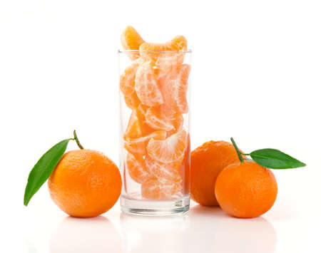 Fresh Tangerine and Segments in a Glass Isolated on White Stock Photo