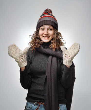 Young woman in warm clothing smiling looking at camera
