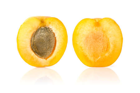 Apricot Cut in Half on White Background Stock Photo
