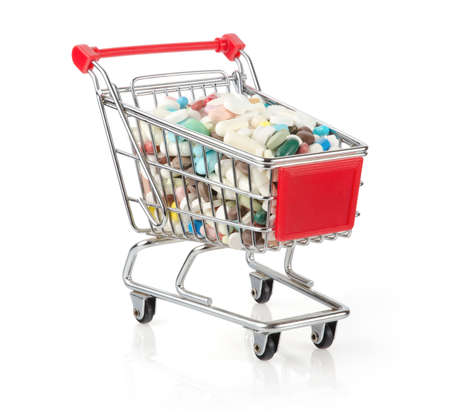 Shopping Cart Filled with Capsules Isolated On White Background
