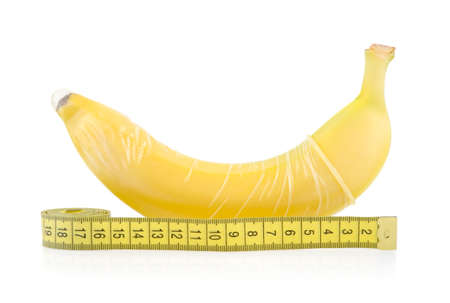 Yellow Banana with Condom and Measuring Tape Isolated on White Background
