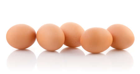 Five brown eggs on white background with clipping path
