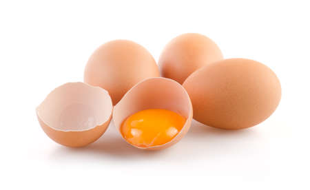 white eggs: Brown Eggs with one broken on white background