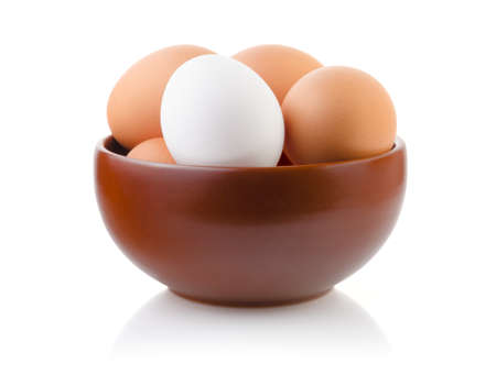 Eggs in a Bowl on white background with clipping path Stock Photo