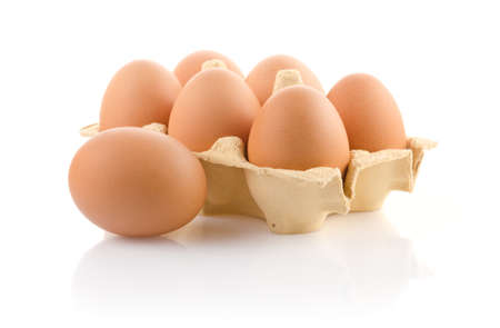 Brown eggs in carton on white with clipping path Imagens