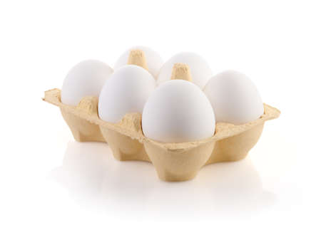 Six Eggs in carton on white with clipping path Stock Photo
